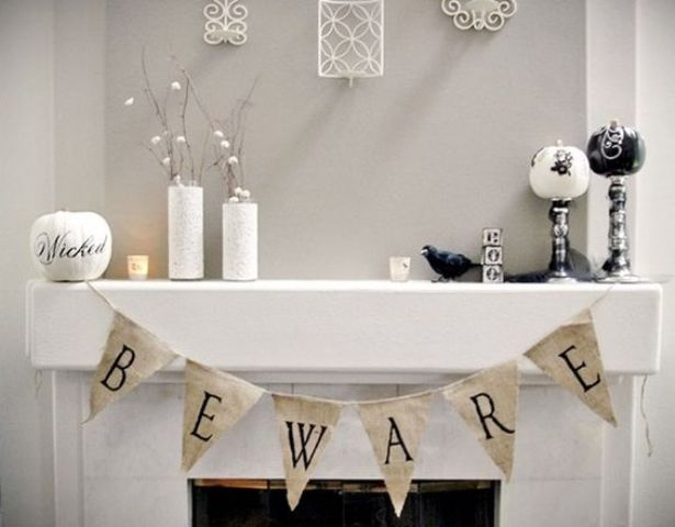 25-white-halloween-mantel-decor-with-a-banner-and-several-pumpkins-on-stands